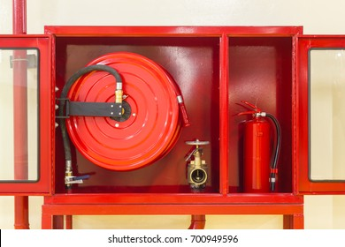 Closed-up red cabinet (The door was opened) for Fire Extinguisher, Fire Hose and Fire Hose Valve