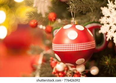 Closed-up red ornament on blur christmas tree with bokeh light b