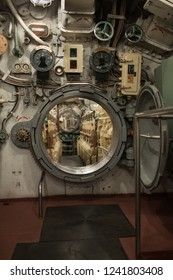 closely inside the submarine, round hatch in the engine room