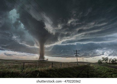 Closer than weâ??ve ever been to a tornado before, we witnessed this unbelievable tornado form in a field right next to our car whilst storm chasing in Colorado, USA.