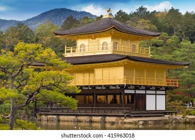 Closer view showing building of golden Kinkaku-ji Temple, Japan's heritage, Kyoto, Japan