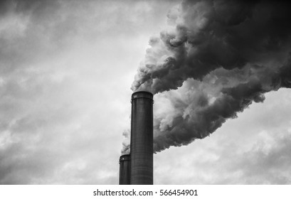closer up view of smoking smokestacks in Black and White