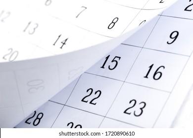 Closes a calendar page in blue. flipping calendar