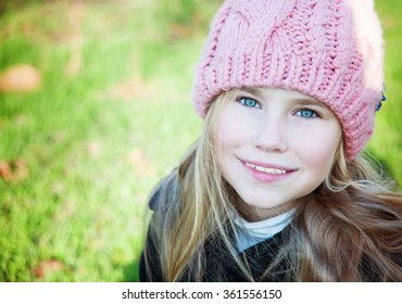 Closesup portrait  little girl in pink hat smile