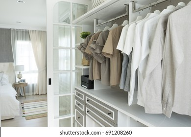 closet with cloth and shelf at home