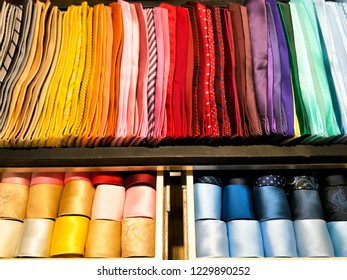 Closet with a hundred of colorful necktie.  Many pattern and color of them.  Men decoration.