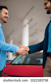 Close-uo of shaking hands after a successful car buying focus on hands