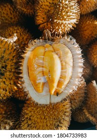 Close-up of 1 ripe durian. Ready to eat. Close up of peeled yellow musang king durian. Durian taste is combination of sweet and creamy all at once. A pack of durian.