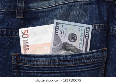 Close-up of a $ 100 bill in a jeans pocket