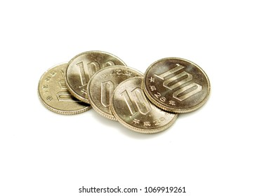 Closeup 100 Japan yen currency coins stacked on white background