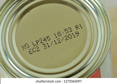Close-up of 2019 expiration date on canned food