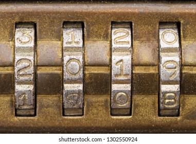 closeup of 2019 on old brass combination lock dials