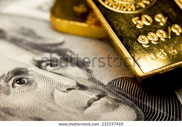 Close-up of a 20-dollar banknote (figuring president Jackson) and a gold bullion