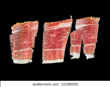 Closeup of 3 serrano ham slices isolated over black background