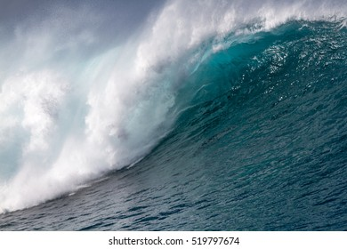 Close-up of a 35-40 foot Ocean wave shot from a wave runner on the north shore of Oahu Hawaii outer reef break at Pipeline