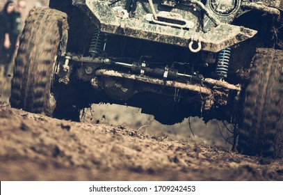 Close-up Of 4x4 Sport Utility Vehicle On Muddy Terrain