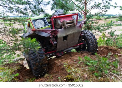 Closeup of 4x4 truck driving uphill with winch