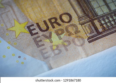 Close-up of a 50 euro bank note, the word Euro in three alphabets, Latin, Greek and Cyrillic