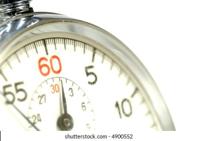 Close-up of 60 second stop watch- crystal of watch is scratched so numbers appear soft but image is in focus