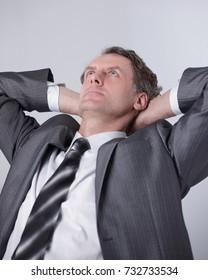 closeup .a successful businessman relaxarea sitting behind a Desk