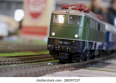 Close-up about model train on the rail tracks