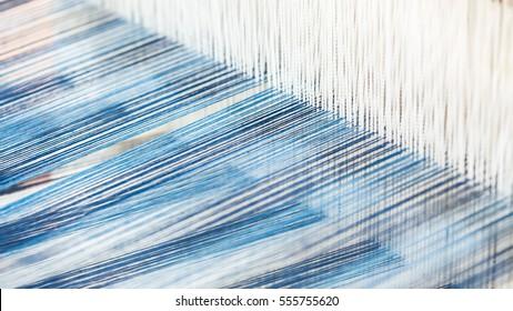 Closeup, abstract motion blur of silk fabric weaving