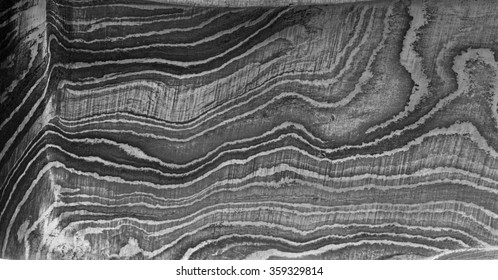 Closeup of the abstract wave patterns created in the steel due to the folding process in a Damascus blade