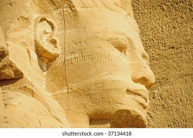 Close-up of the Abu Simbel monument showing statue of Face of Rameses II in Egypt