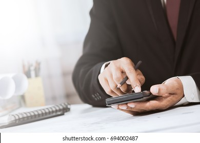 Close-up of accountant hands with calculator in construction work office