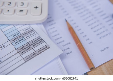 closeup accounts number on a printed paper ,Calculator and pencil. finance business sheet .