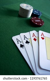 Close-up of aces poker on the table