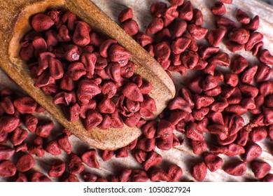closeup of achiote seeds used for natural food colouring