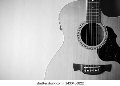 Closeup acoustic guitar on brown background. Acoustic guitar that is classic and beautiful