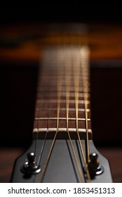Close-up acoustic guitar on wooden background. Soft focus