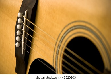 Close-Up of Acoustic Guitar and Strings