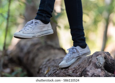 Close-up of Active backpacker hiker feet walking on forest trail, traveling concept .