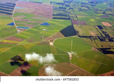 Closeup aerial view of Canterbury Plains as the mist clears on an Autumn morning, New Zealand. In the background are the Southern Alps.