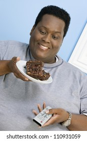 Close-up of African American obese man looking at pastry