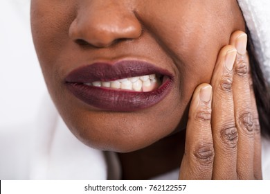 Close-up Of An African Woman Having Tooth Pain