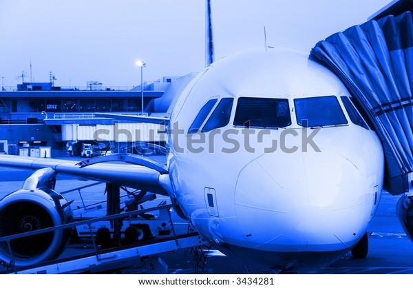 Close-up of aircraft ready for departure, early morning flight.  Blue monochrome