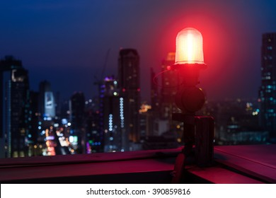 Closeup of an aircraft warning light on top of a highrise of building in night  time. for  safety concept