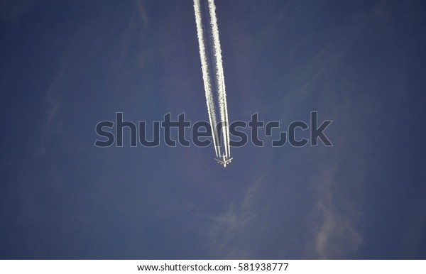 Close-up of an airplane, on a blue sky background