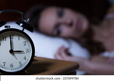 Close-up of alarm clock on night table