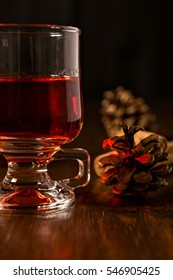 Closeup of alcoholic punch drink and pine cone
