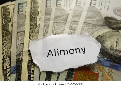 Closeup of Alimony paper note on cash