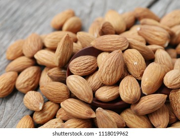 Closeup of Almond on wooden table background.