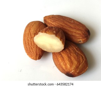 Closeup of almonds, isolated on the white background