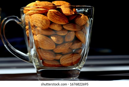 Closeup of Almonds in a transparent glass cup