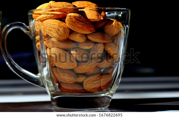 Closeup of Almonds in a transparent glass cup