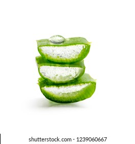 Closeup of aloe vera slices with water drop isolated over white background. Organic herbal ingredient for alternative medicine and skin and hair treatment beauty product.